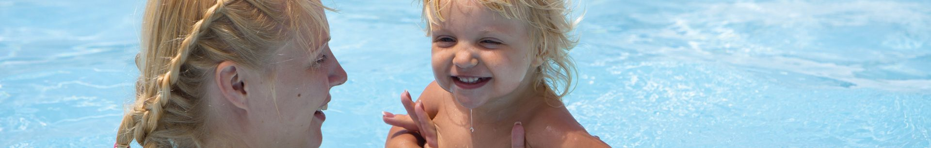 Young child learning to swim.